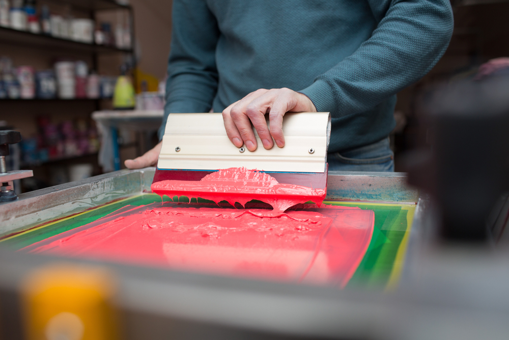 Man doing Screen Printing by Hand